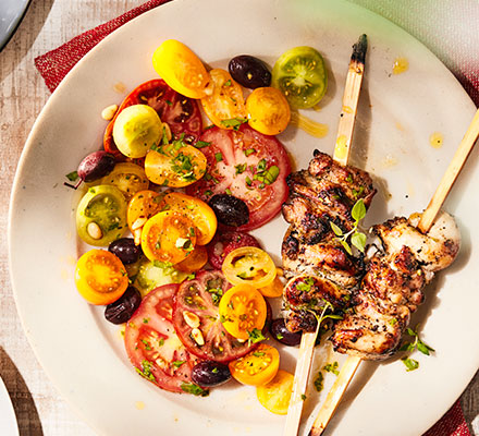 Preserved lemon chicken skewers with summer tomato salad