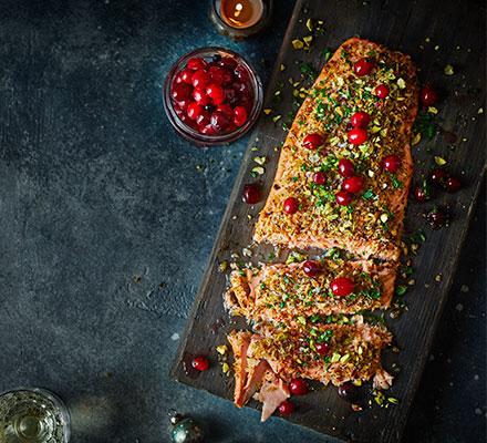 Baked salmon fillet with pickled cranberries, parsley & pistachios