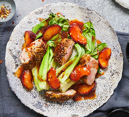 One-pan coriander-crusted duck, roasted plums & greens