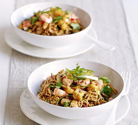 Spiced Singapore noodles with cauliflower, chicken & prawns