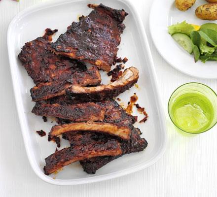 Sticky ribs with roast potato salad