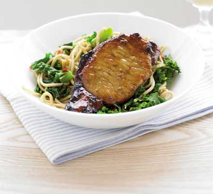 Sticky pork with gingered noodles & kale