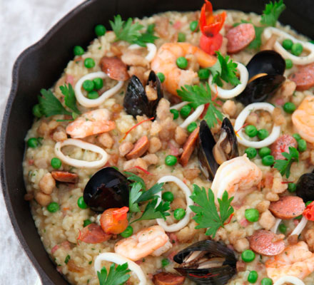 Paella with seafood, chicken and chorizo