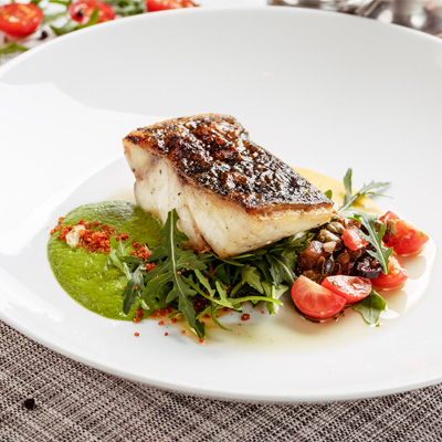 Roasted fish with herb purée and fennel confit dressing